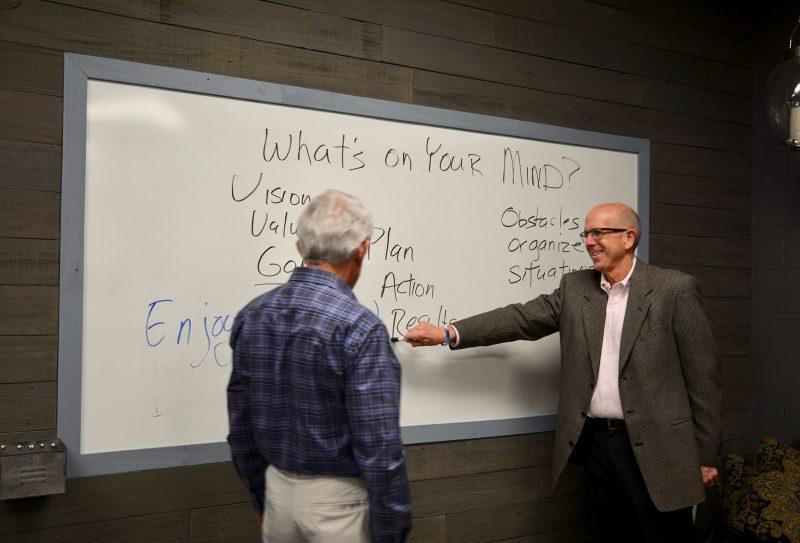 Michael writing on whiteboard
